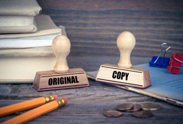 Como a microfilmagem reduz o risco de falsificação de documentos na sua empresa?